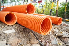 Plastic drainage pipe buried in the ground Stock Photos