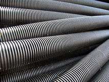 Plastic Drainage Pipes. Stack of black plastic drainage pipes for sewage Stock Photos