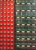 Plastic drawers. Red and green plastic drawers for small parts royalty free stock photos