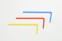 Plastic drinking straws. Three plastic bendy drinking straws Stock Photography