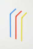 Plastic drinking straws. Three plastic bendy drinking straws Stock Photo
