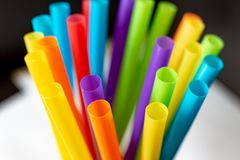 Plastic drinking straws and tubes royalty free stock photo