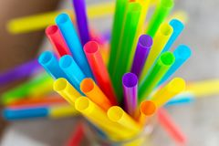 Plastic drinking straws and tubes stock photos
