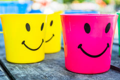 Plastic Drinking Water. Beautiful colorful plastic drinking bowl. With a lovely smile Stock Photo