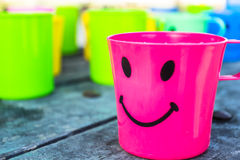 Plastic Drinking Water. Beautiful colorful plastic drinking bowl. With a lovely smile Royalty Free Stock Photo