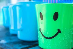 Plastic Drinking Water. Beautiful colorful plastic drinking bowl. With a lovely smile Royalty Free Stock Photos