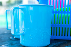 Plastic Drinking Water. Blue plastic bowl of water Place the basket Stock Photos