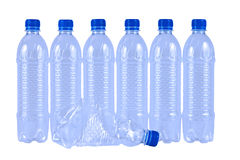 Plastic drinking water bottles. Seven plastic drinking water bottles isolated on white background Stock Images