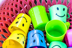 Plastic Drinking Water. Colorful plastic bowl of water placed in the basket. With a lovely smile Stock Images