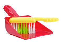 A plastic dustpan and brush Royalty Free Stock Images