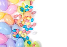Plastic easter eggs and candy. Plastic easter eggs filled with candy  on a white background Stock Photo