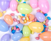 Plastic easter eggs and candy. Plastic easter eggs filled with candy  on a white background Royalty Free Stock Image