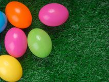 Plastic easter eggs on grass. Top view Royalty Free Stock Photo