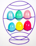 Plastic Easter eggs in a wire rack. Rack holds plastic Easter eggs Stock Photo