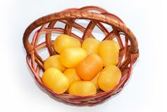Plastic egg boxes in basket on the white background. Easter holiday stock photos