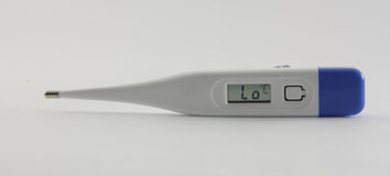 Plastic electronic thermometer. On the white background Stock Image