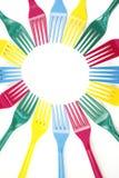 plastic färgrika gafflar för bakgrund Arkivbild