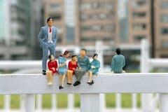 Plastic fake miniature people Stock Photo