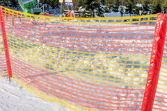 Plastic fence on the ski slope Royalty Free Stock Image