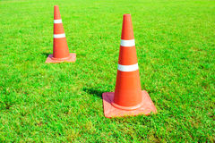 Plastic field cones on green grass seamless texture in soccer fi Stock Photos