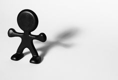 Plastic figurine. Black plastic figurine representing a man isolated on white Stock Images