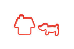 Plastic figurine of the house and the dog. Toy. Royalty Free Stock Image