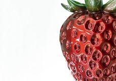 Plastic figurine of strawberry on a white background royalty free stock image