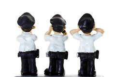 Plastic Figurines of  Policemen, rear view Royalty Free Stock Image