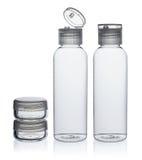Plastic flessen en kruik voor schoonheidsmiddelen Stock Foto