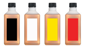 Plastic flessen met gekleurde binnen vloeistof Royalty-vrije Stock Afbeelding