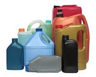 Plastic flessen van automobiele geïsoleerde oliën stock afbeeldingen