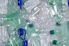 Plastic flessenachtergrond stock afbeelding