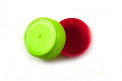 Plastic flessenschroefdeksels Stock Foto's