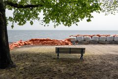 Plastic flood protection sandbags stacked into a temporary wall. White and orange plastic flood protection sandbags stacked into a temporary dam royalty free stock photo