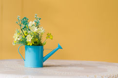 Plastic flower in blue pot Royalty Free Stock Photos