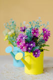 Plastic flower in blue pot Stock Photography