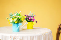 Plastic flower in blue pot Royalty Free Stock Photo