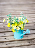 Plastic flower in blue pot Royalty Free Stock Image