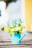 Plastic flower in blue pot Stock Photo