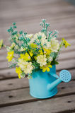 Plastic flower in blue pot Royalty Free Stock Images