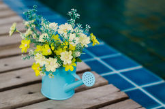 Plastic flower in blue pot Royalty Free Stock Photography