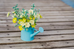 Plastic flower in blue pot Stock Photo
