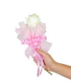 Plastic flower bouquet in hand isolated on white background Royalty Free Stock Image
