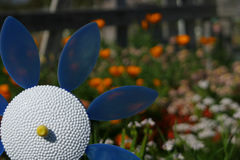 Plastic Flower in the Garden. A plastic flower pinwheel blows in a community garden stock images