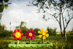 Plastic flower in orchard Stock Image