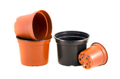 Plastic flowerpots for flowers and seedling isolated on white Royalty Free Stock Photos