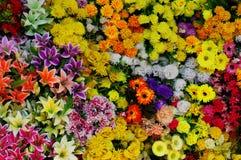 Plastic flowers background 2 Royalty Free Stock Image