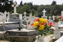 Plastic flowers on a greek cemetery. With shallow DOF Royalty Free Stock Image