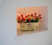 Plastic flowers niche decoration Royalty Free Stock Photo