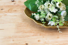 Plastic flowers in a pottery dish Royalty Free Stock Photos